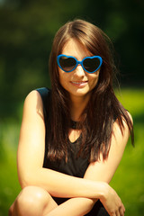 Summer. Portrait of woman in blue sunglasses outdoor