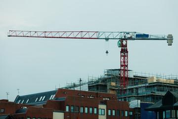 Construction site building hoisting crane