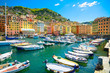 Camogli marina harbor, boats and typical colorful houses. Ligury
