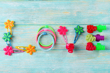 Love word formed with colorful scrunchies on wooden background