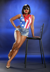 Caribbean girl in star-spangled attire