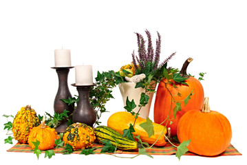 Decoration with more pumpkins and candle on isolated background