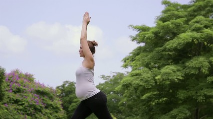 6of10 Pregnant woman, girl doing yoga, pregnancy
