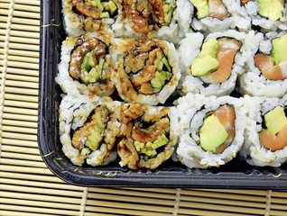 Tightly packed sushi rolls on platter