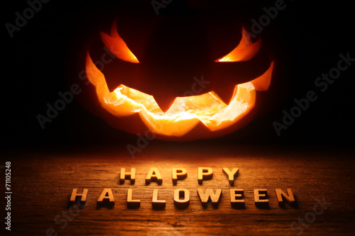 canvas print picture Spooky Halloween background with jack o lantern