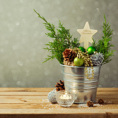 Christmas table decoration with balls and pine corn