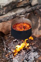 Borscht (Ukrainian soup) cooking on campfire