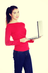 Young woman working on her laptop computer