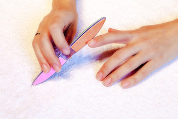 Alignment nails using nail files during a manicure