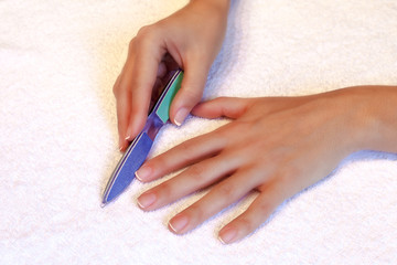 Nail treatment nail file during a manicure