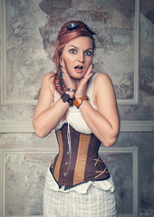 Beautiful steampunk woman surprised