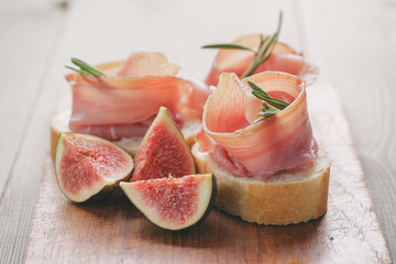 canapes with jamon and figs on table