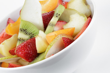 fresh mix fruit salad with strawberry, kiwi and peach