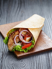 tasty fresh wrap sandwich with chicken and vegetables