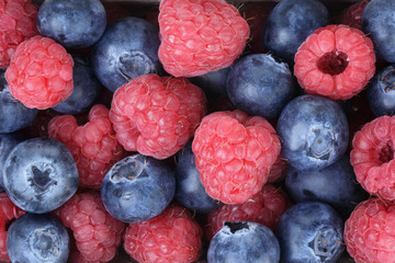 ripe blueberries and rasperries