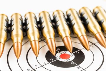 Machine gun bullet chain over target background