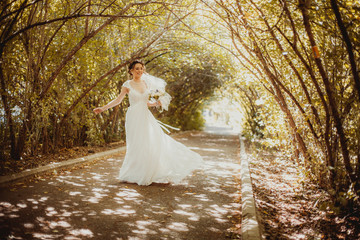 Vintage bride outdoors with bouquet
