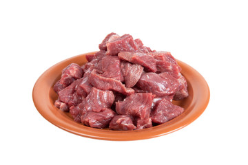 Pieces of beef on a plate isolated on white background