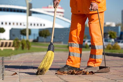 Leinwanddruck Bild Street Sweeper cleaning footway with broom tool and dustpan