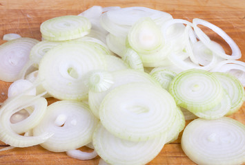 Sliced onion on a wooden board