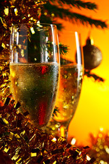 glasses with champagne and Christmas ornaments
