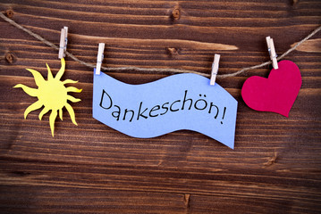 The German Word Dankeschön on a Purple Label