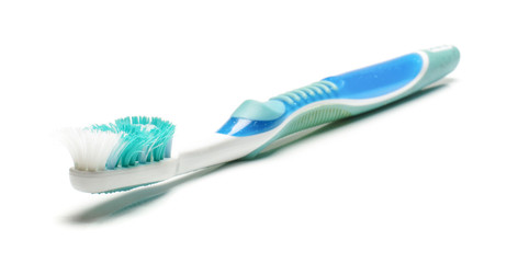 Old dirty used toothbrush isolated on the white background