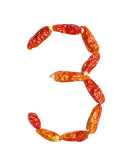 Number 3 arranged from chili peppers isolated