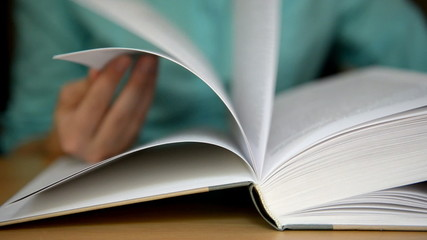 Turns pages of the book
