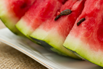 Slices of red watermelon on a plate