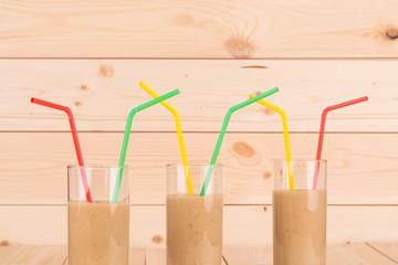 Banana fresh juice with straw.