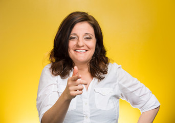 woman laughing smiling pointing finger at someone