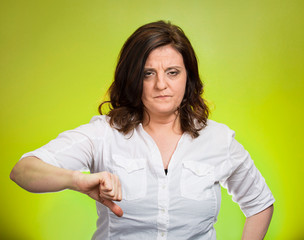 pissed off woman, giving thumb down green background