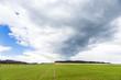 dark clouds over fields in spring