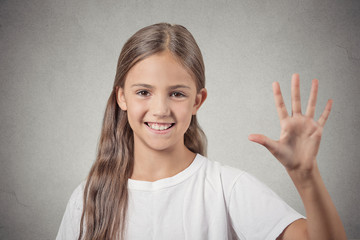 girl making five times sign gesture with hand grey background