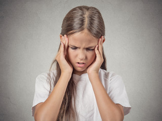 Headshot stressed child, teenager girl on grey background
