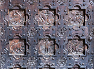 Details of old decorative medieval wooden door