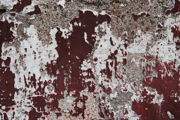 Old plastered surface burgundy and white