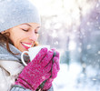 Beautiful happy smiling winter woman with hot drink outdoor