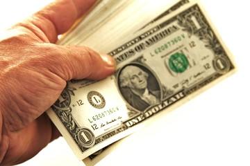 Dollarnoten in der Hand isoliert