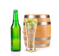 Beer bottle and mug with hops.