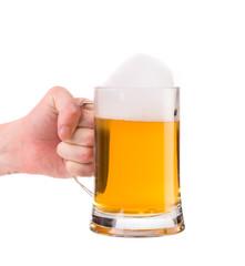 Hand holding mug of beer.