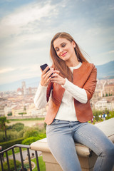 Beautiful young woman making a picture with background of Floren
