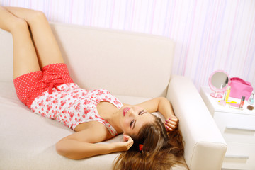 Pretty girl lying on the couch