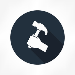 hammer in hand icon