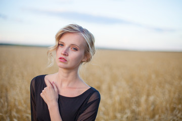 Beautiful woman standing in a grassy field