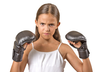 teenager girl wearing boxing gloves ready to fight