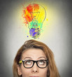 woman having brilliant idea colorful lightbulb above head