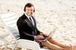 Businessman on the beach - 71119074