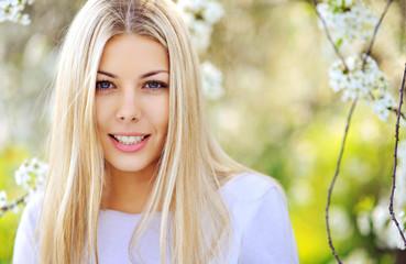 Portrait of beautiful female model on nature background